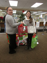 Photo: Jessica from Water Tower Workers Credit Union and Kylee receiving gifts for the kare kits kidz.