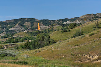 Photo: Throughout the Bakken Oil Field we saw natural gas being flared.