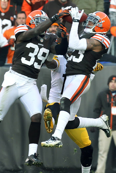 Photo: Joe Haden intercepts a pass intended for Mike Wallace. (Chuck Crow, The Plain Dealer)
