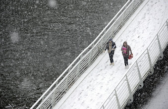 Photo: Two women cross a bridge in heavy snow in Durham as the first wave of snow will hit most of the country and some eastern parts of Wales but a second heavier band will fall over central and eastern England later in the day. PRESS ASSOCIATION Photo. Picture date: Monday January 14, 2013. See PA story WEATHER Snow. Photo credit should read: Owen Humphreys/PA Wire