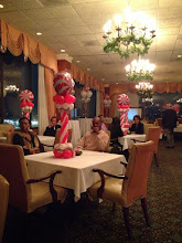 Photo: room view of candy swirl centerpieces