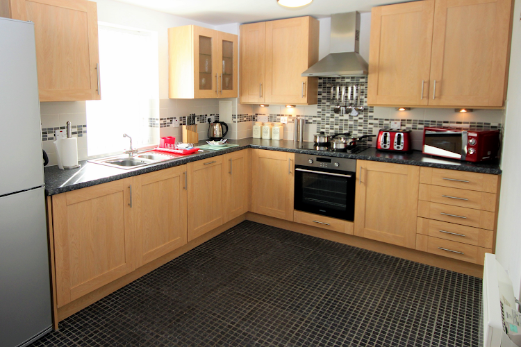 Fully equipped kitchen at Knightsbridge Court PU