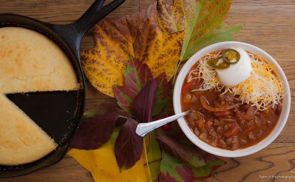 Over low heat, bring the chili to a low boil slowly.  When it's...