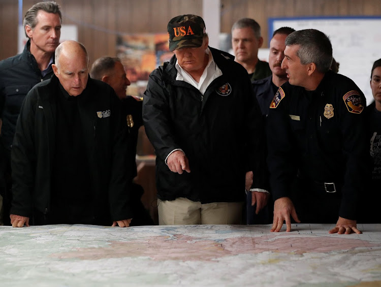 US President Donald Trump speaks during a briefing by state officials while visiting fire-ravaged Paradise, California, the US, November 17 2018. Picture: REUTERS/LEAH MILLS