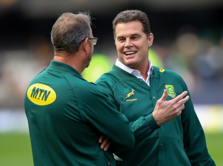 Springbok coach Rassie Erasmus sharing a moment with Springbok assistant coach Swys de Bruin during the Rugby Championship match between South Africa and Argentina at Jonsson Kings Park on August 18, 2018 in Durban, South Africa.