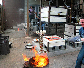 """Photo: Here I'm placing the 19"""" tall tree candelabra into a can of burning paper and sawdust"""