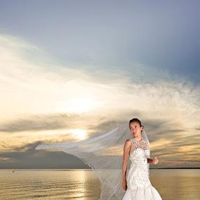 Sunset Bride Lookback by Andrew Morgan - Wedding Bride ( weddingdress, zanzibar, sunset, wedding, beautiful, destinationwedding, islands, sea )