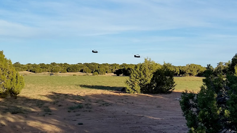 Photo: Helicopters flying low near camp