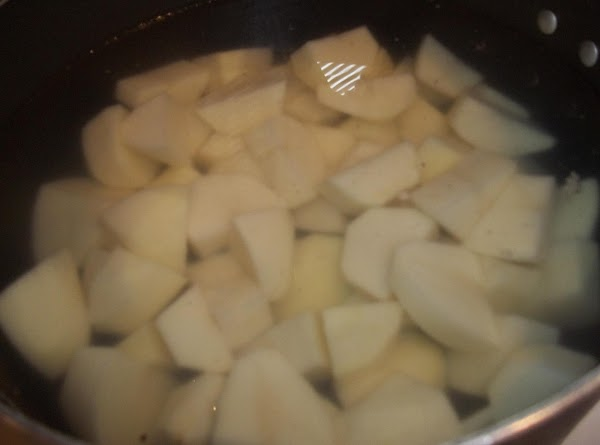 Peel potatoes and cut into large chunks. Place in a large saucepan of water,...
