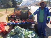 Norris Phaswana sells fruit and vegetables off the back of his bakkie in Louis Trichardt.