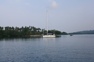 Photo: Oyster Island Anchorage, Note the resort and floating grass hut ferry boat in the foreground