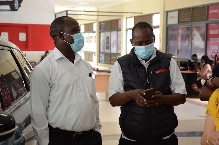 Yahama brand manager Cleon Oyugi and Yahama Motor consultant Charles Mulwa