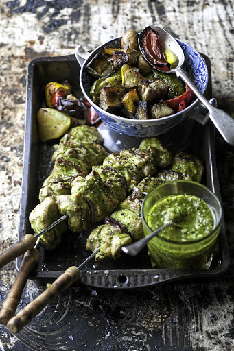 Chicken kebabs with pesto roasted veggies.