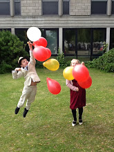 Photo: Younger members of the audience achieve lift-off with balloons after the Sunday concert, the final event in Summer Music Week!