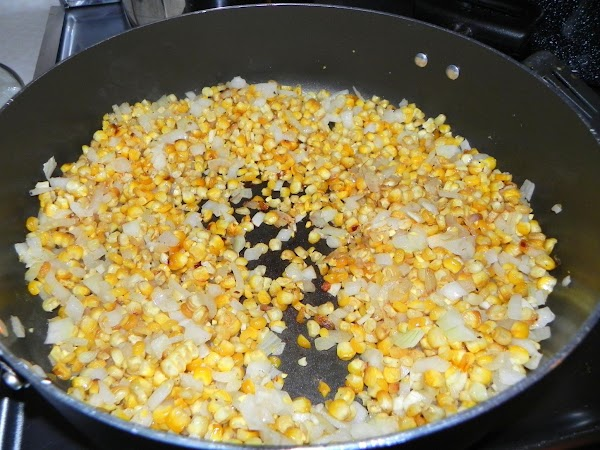 Heat oil in a large, heavy saucepan over medium heat. Add onion and a...