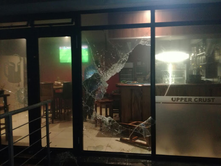 Protesters in Muizenberg petrol bombed a residential area and restaurant on Tuesday evening.
