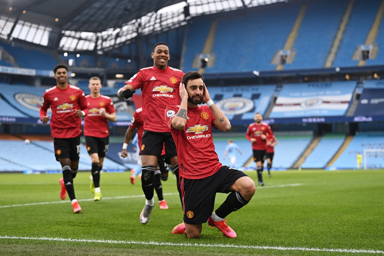 Bruno Fernandes of Manchester United celebrates after scoring their side's first goal from the penalty spot during the Premier League match against Manchester City at Etihad Stadium in Manchester, England, on March 7 2021 . Picture: GETTY IMAGES/LAURENCE GRIFFITHS