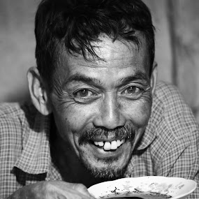 Having a saucer of coffee by Adi Krishna - People Portraits of Men