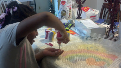 Photo: more work on the canvas - she's getting into it!