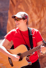 Photo: Cantor Rollin Simmons on guitar, under Corona Arch, leading the Passover Seder in Moab, Utah.