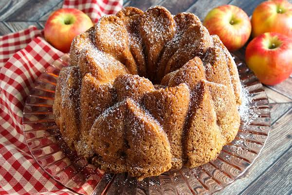 Layered Fresh Apple Cake Dusted With Powdered Sugar.