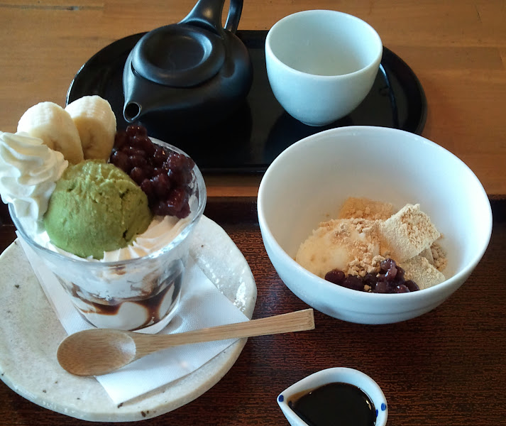 Photo: OK, this stuff should be illegal. Illegal, I tell ya. The one on the left is a parfait with soy blancmange (which is like a pudding), macha ice cream, red beans, bananas and whipped cream. The one on the right is warabi mochi with ice cream, red beans, kinako powder and a side of sweet kuromitsu. Not sure but I also suspect both have a sprinkling of crack in them 'cause I couldn't stop eating even though I was full. Why yes, officer, you can cuff me now.