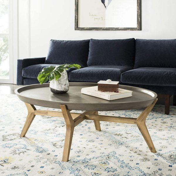 http://cdn.home-designing.com/wp-content/uploads/2021/04/large-oval-coffee-table-real-concrete-tabletop-with-lip-sturdy-solid-wood-legs-light-natural-finish-unique-industrial-scandinavian-furniture-600x600.jpg