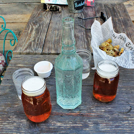 Fried Pickles, IPA and Water by Diane Garcia - Food & Drink Alcohol & Drinks ( fried pickles, wooden table, furniture, bottle, water, beer )