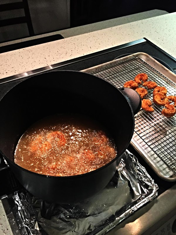 Pour oil in a small deep fryer and heat to 350 degrees. Dredge shrimp...