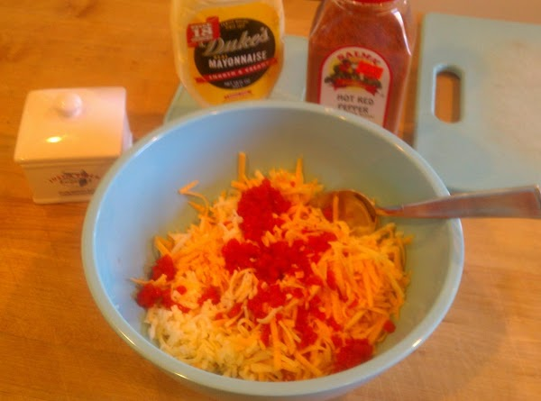 Mix the shredded cheese together with the pimientos stir well, stir in cayenne pepper...