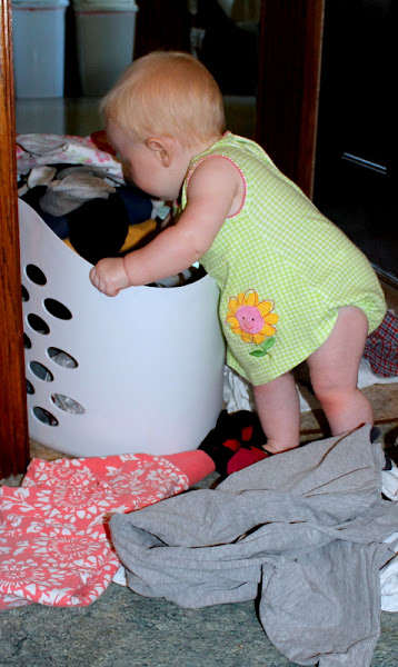 Photo: Yes, Mommy's clean, nicely folded laundry is now all over the floor. ;)