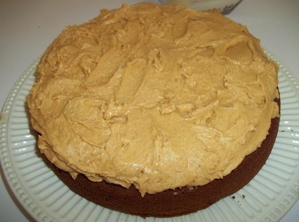 Place one cake layer, rounded side down on cake platter. Spread thick layer of...