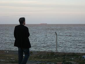 Photo: Jason Hoffman contemplating the Rio de La Plata, 30 miles wide to Uruguay