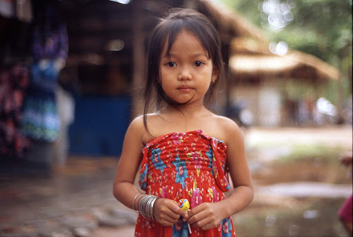 A young girl, about 3 years old, in Angkor Thom, Cambodia.