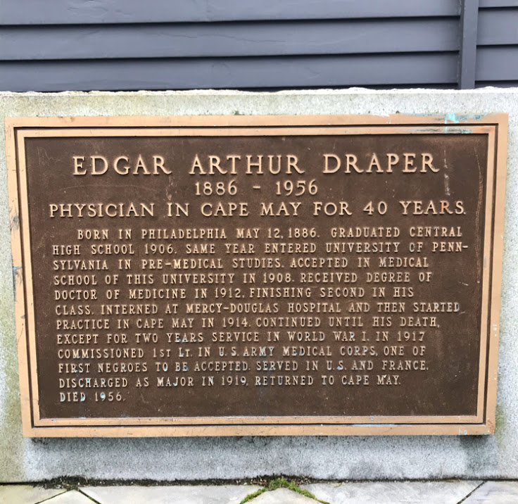 This historic marker hides in the alley.