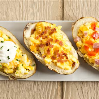 Breakfast Baked Potato Boats Stuffed with Cheesy Eggs.
