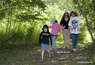 Photo: Kitty Goldberg, her children Scott and Zeph Watkins and Ronda Anderson of New York walk the trails at Waterbury Ctr State Park. Photo by Karen Pike