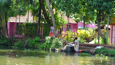 Photo: Lady is doing laundry in the canal.