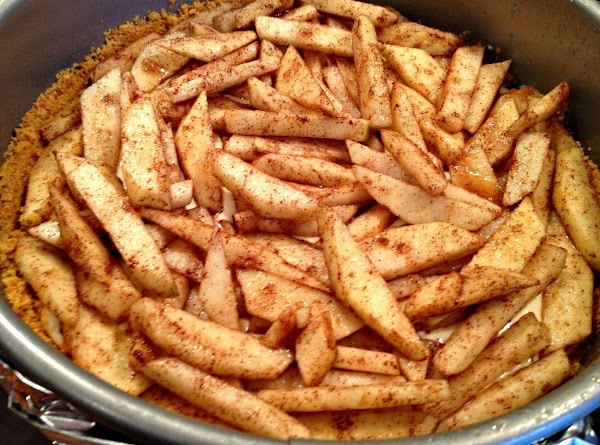 Pour half the cream cheese mixture over crust. Arrange apples over the cream cheese...
