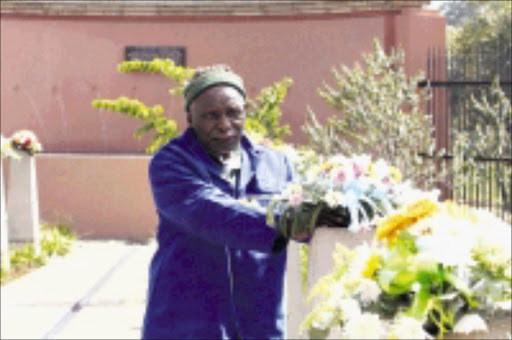 REMEMBRANCE: Azanian People's Liberation Army veteran Buti Mofokeng lays fresh flowers during the commemoration of the Sharpeville massacre at the Sharpeville Human Rights Precinct on Saturday.  21/03/2009. Pic. Bafana Mahlangu. © Sowetan.