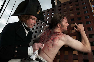 Photo: The ship's surgeon tends to the wounds of the seaman who has been flogged.