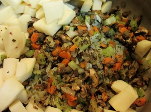 Brown ground beef, drain well and pour into large soup pan. Saute the onion,...