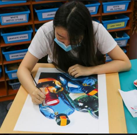 Student taking Art Exam