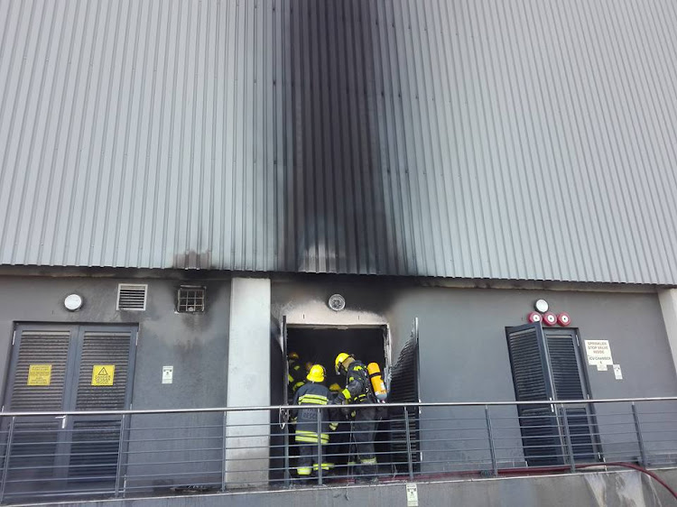 Cape Town fire and rescue services try to contain the fire at a Shoprite warehouse in Cape Town on May 15, 2018.