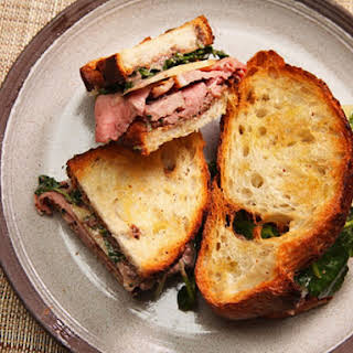 Leftover Lamb Sandwiches With Tapenade Mayo, Watercress, and Caciocavallo Cheese.
