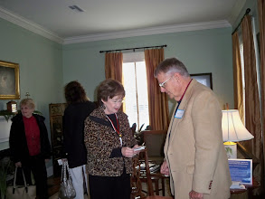 Photo: 2010 December 5 Perkins Adams House (The Stockton House) 307 North Wall Street Home of Margaret Perkins & Rene Adams  Former Friends President Linda Ogden collects tickets