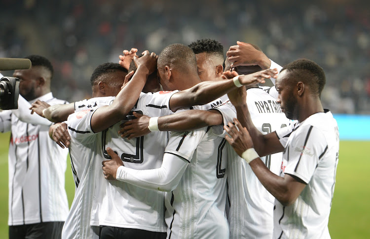 Innocent Maela and teammates celebrate after scoring one of the goals during the 3-1 Absa Premiership win over Bloemfontein Celtic at Orlando Pirates on August 3 2019.