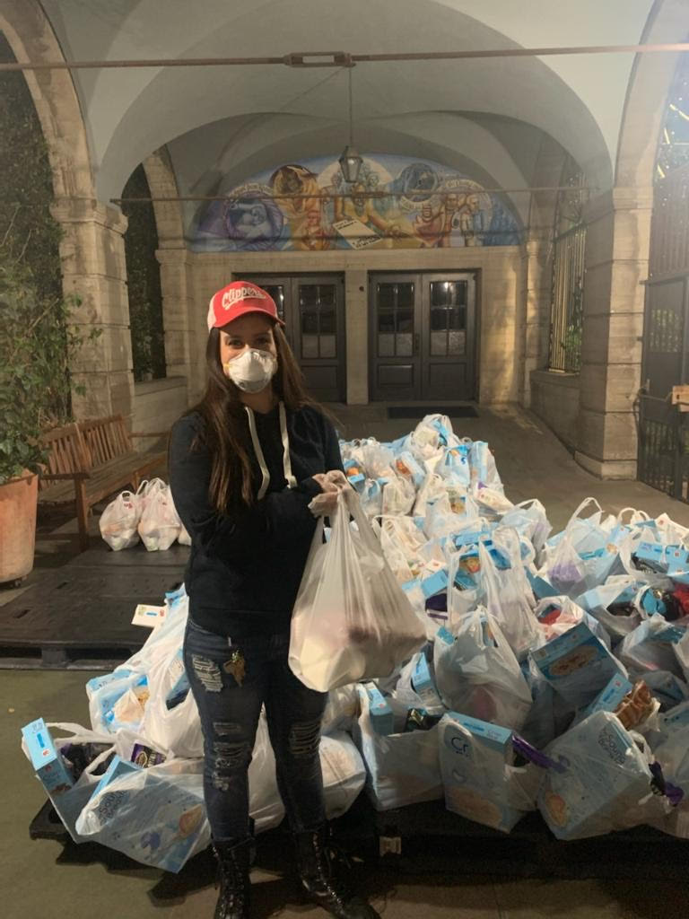 Masked woman with bags for donation