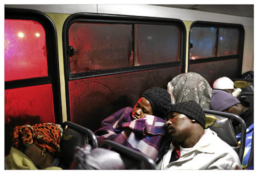 Long ride: Domestic worker Khosi Mahlangu's gruelling day starts at 2am, when she prepares to take a bus from Machiding village in Mpumalanga to her workplace in Pretoria East. Research shows the poor shoulder the biggest transport burden because of the spatial legacy of apartheid. Picture: THE TIMES