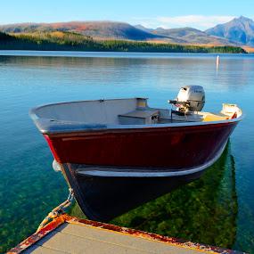 Lake McDonald Glacier National Park by Kimberly Sheppard - Transportation Boats ( water, mountains, red boat, pier, lake, boat, device, transportation )